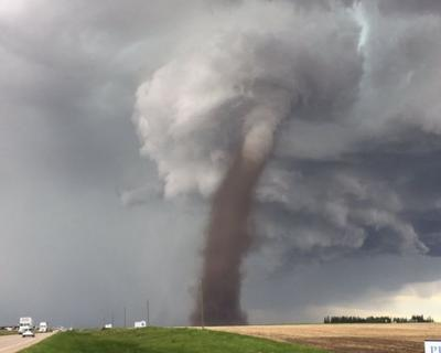 Man Casually Mowing Lawn With Tornado Behind Him Lights Up The Internet