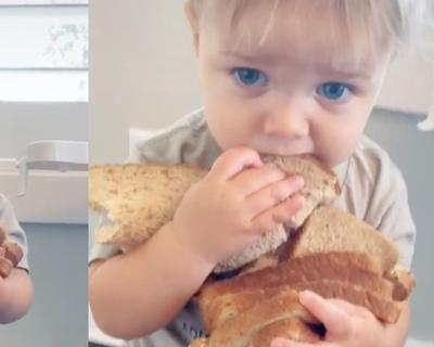 Toddler refuses to give up loaf of bread he is cuddling in adorable TikTok video